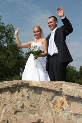Bride and groom wave goodbye