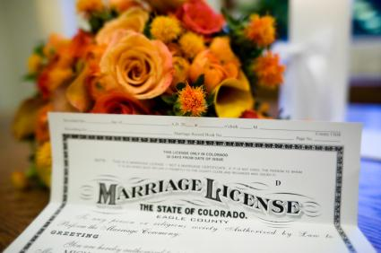 marriage license in front of bouquet