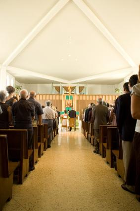 guests in pews at wedding