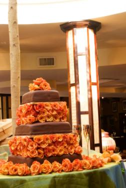 Chocolate wedding cake with burnt orange roses