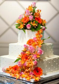 Square cake with dots and cascading flowers