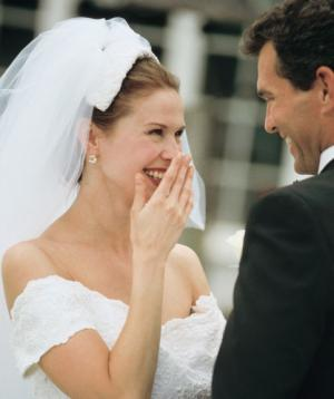 Giggling bride and smiling groom