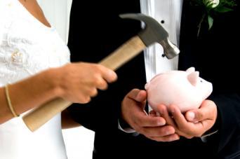 Bride and groom breaking piggy bank