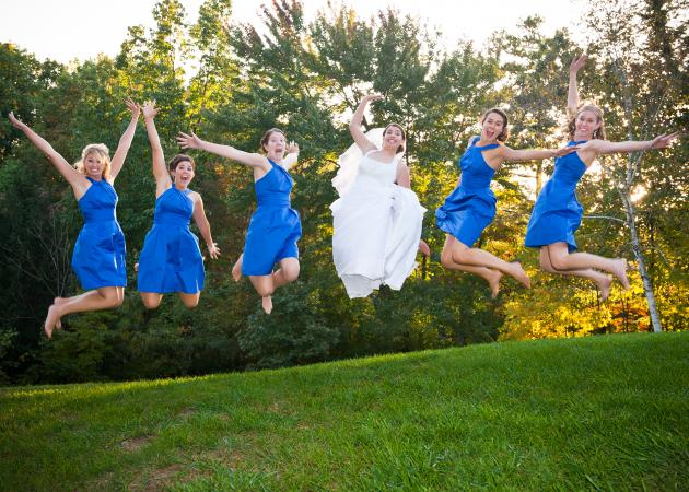 Bridesmaid And Bride Jumping