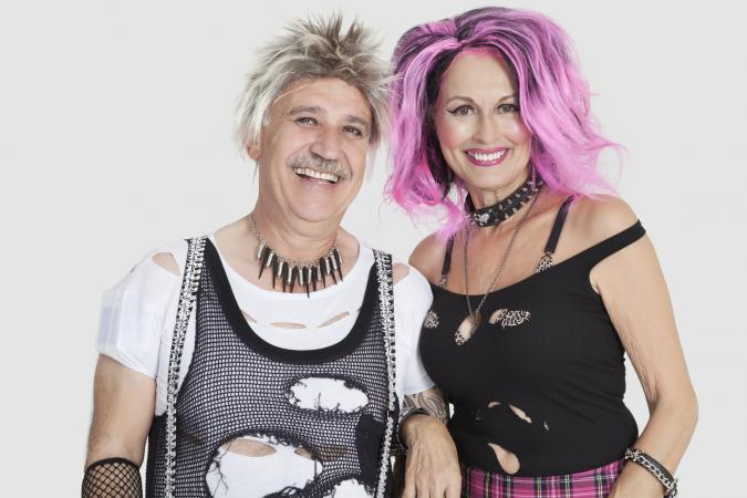 Cheerful senior punk couple