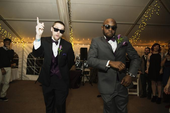 Groom and groomsman dancing