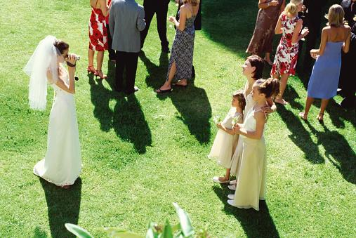 Bride filming bridesmaids
