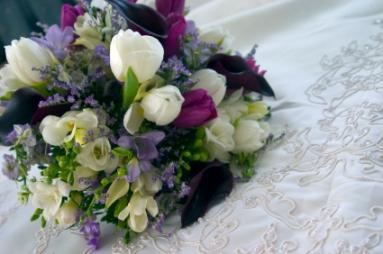 Summer wedding flower ideas lovetoknow flowers on a wedding dress junglespirit Choice Image