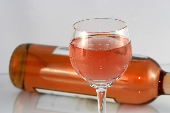 Glass of white zinfandel with bottle
