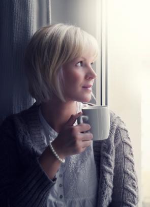 Woman in warm cardigan sweater