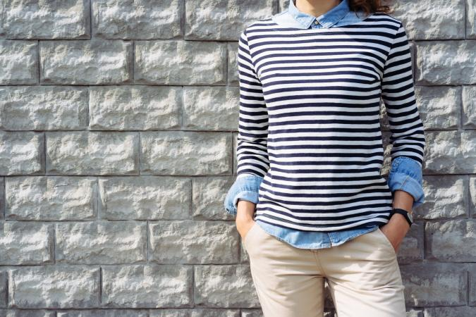 Woman in denim shirt and striped t-shirt