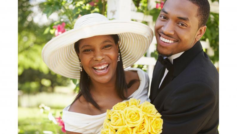 Happy bride wearing hat