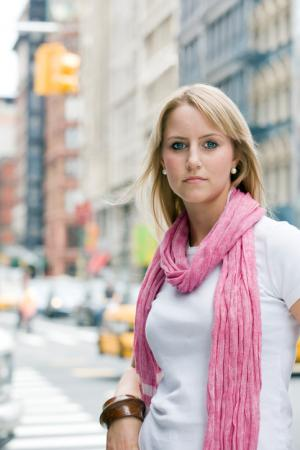 Woman wearing pink scarf