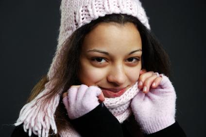 Woman wearing fingerless gloves