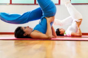 Woman doing yoga at retrreat center