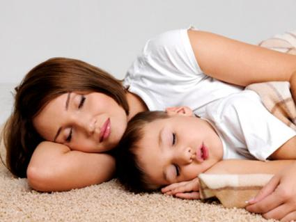 mother and child in yoga sleep