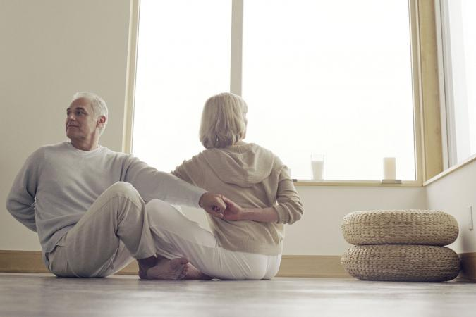 Mature couple stretching together