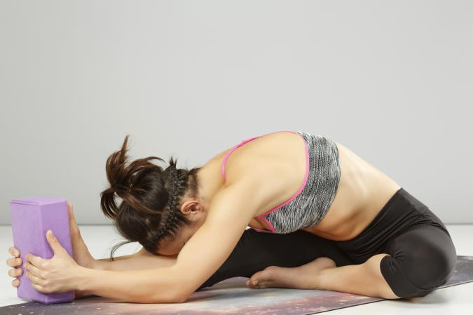 Woman practicing advanced yoga