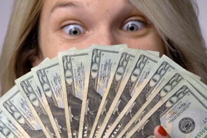 https://cf.ltkcdn.net/addiction/images/slide/113941-424x283-Woman-with-fanned-money.jpg