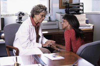Doctor counselling patient