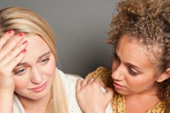 Woman consoling friend