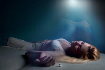 woman lying unconscious