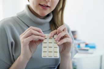 woman holding package of Nicotine Gum