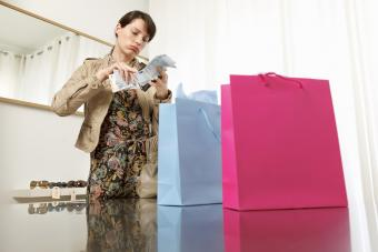 Woman checking money after shopping