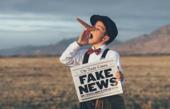 Pinocchio News Boy Holding Fake Newspaper
