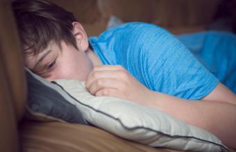 Teenage boy looking depressed