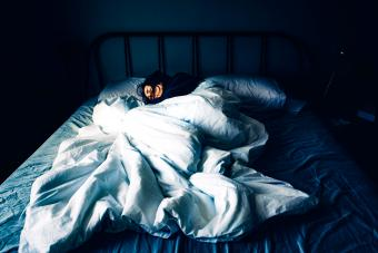 A woman sleeping in bed during the day