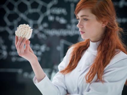 girl holding a mushroom