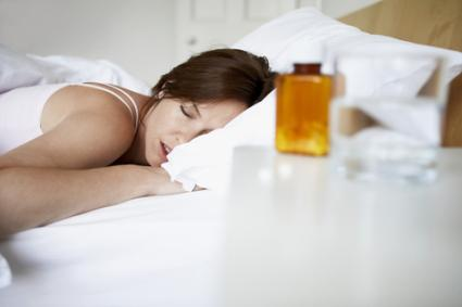 Sleeping woman with prescription on bedside table; © Photographerlondon | Dreamstime.com