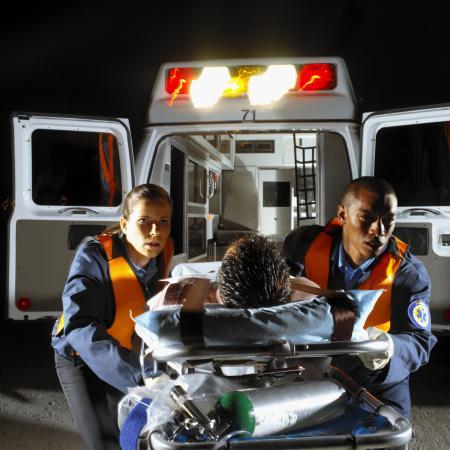 Paramedics wheeling patient on stretcher