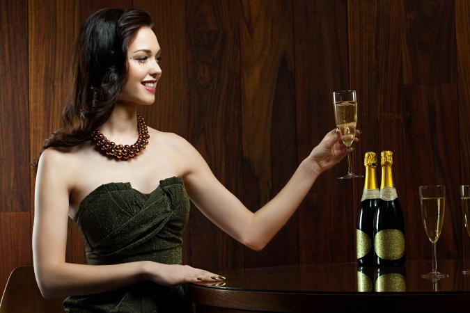 woman sitting at table with champagne