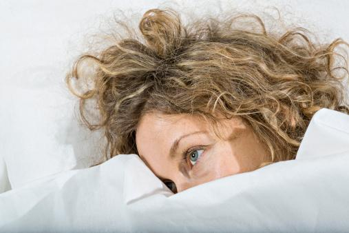 woman awake in bed