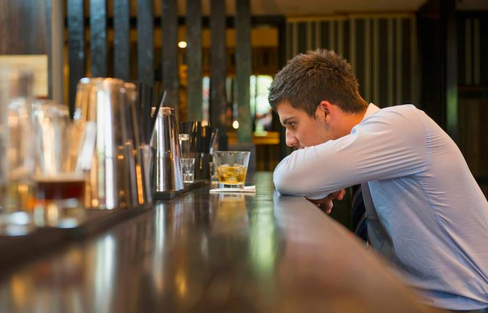 Man drinking alone at the bar