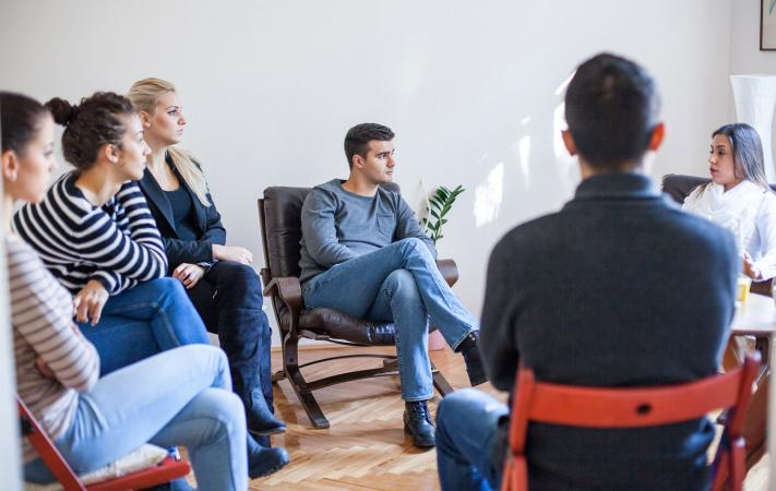 People sitting in group therapy session