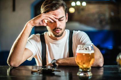 Man Standing Drunk At Bar