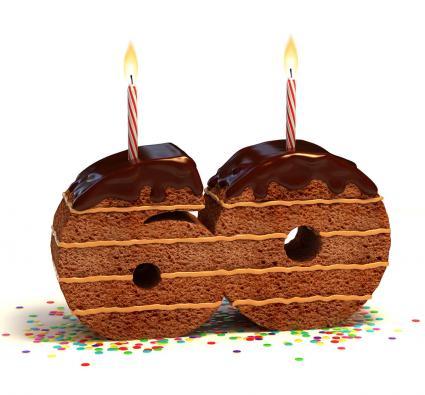 Número sesenta en forma de torta de chocolate