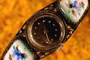 Antique bracelet watch with porcelain floral accents