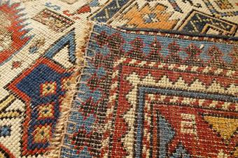 Backside of antique rug