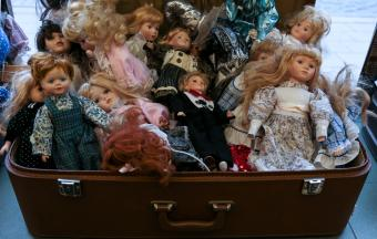 Suitcase full of old porcelain dolls