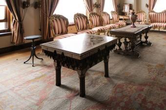 Uniformly faded antique Turkish rug