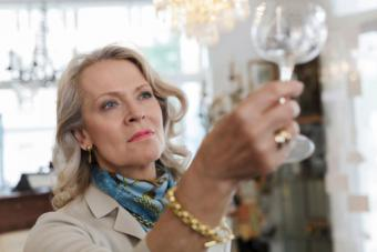 Woman examining antique glass