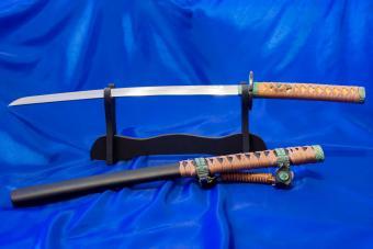 Japanese Katana sword on blue background