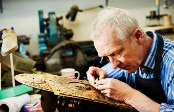 A clock maker busy in his workshop