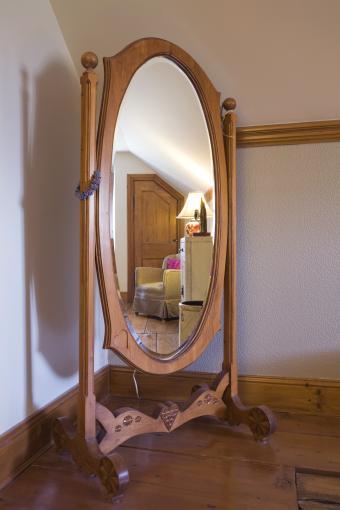 Antique oval wooden revolving dress mirror