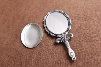 Hand mirror on a table