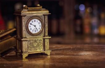 antique clock on a wooden table